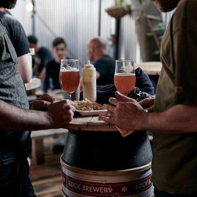 People enjoying beers and food at Brick Brewery, Peckham