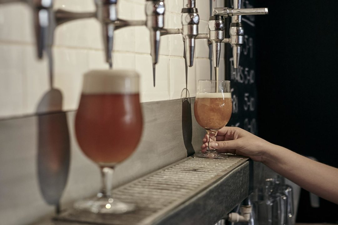 The tap room at Brick Brewery Peckham, pouring a beer